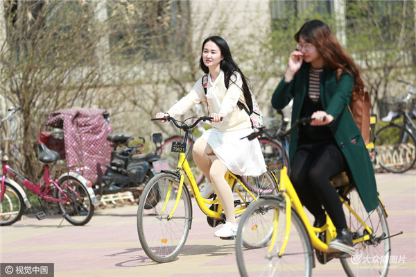 济南:共享单车受大学生欢迎 校园骑行成风景_