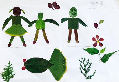 画相结合的方法,充分发挥自己的聪明才智,巧用各种树叶制作出了《海》
